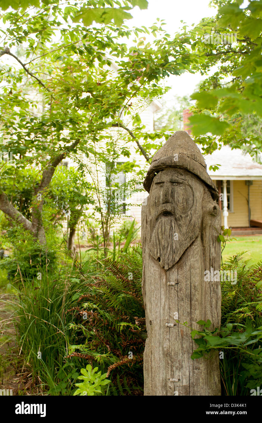 tree stump carving of man in garden of house in Oysterville Long Island Peninsula Washington State USA - Stock Image