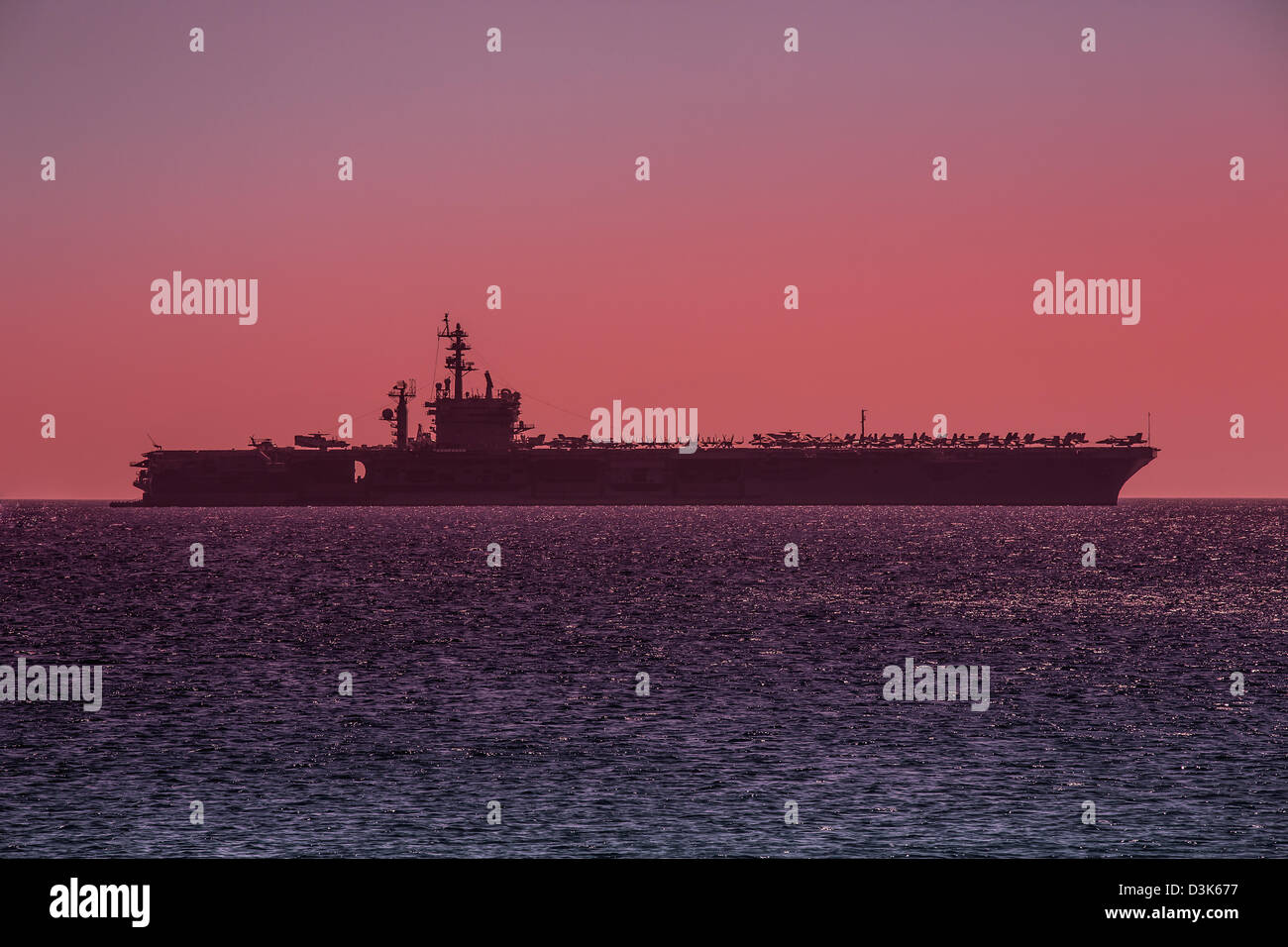Aircraft Carrier, anchored off the coast of Rhodes, Greece. - Stock Image