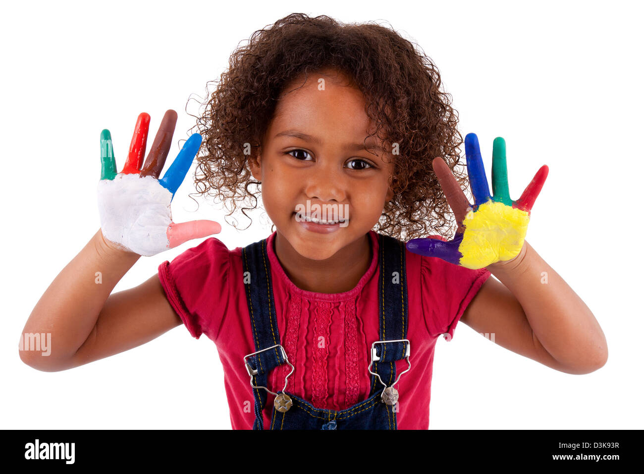 Little African Asian girl with hands painted in colorful paints - Stock Image