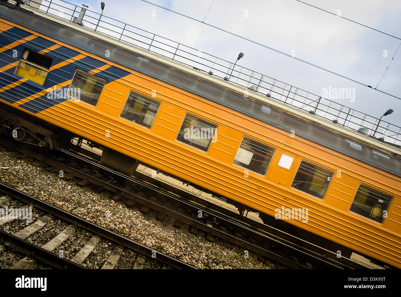Moving passenger car of a train on a railway station - Stock Image