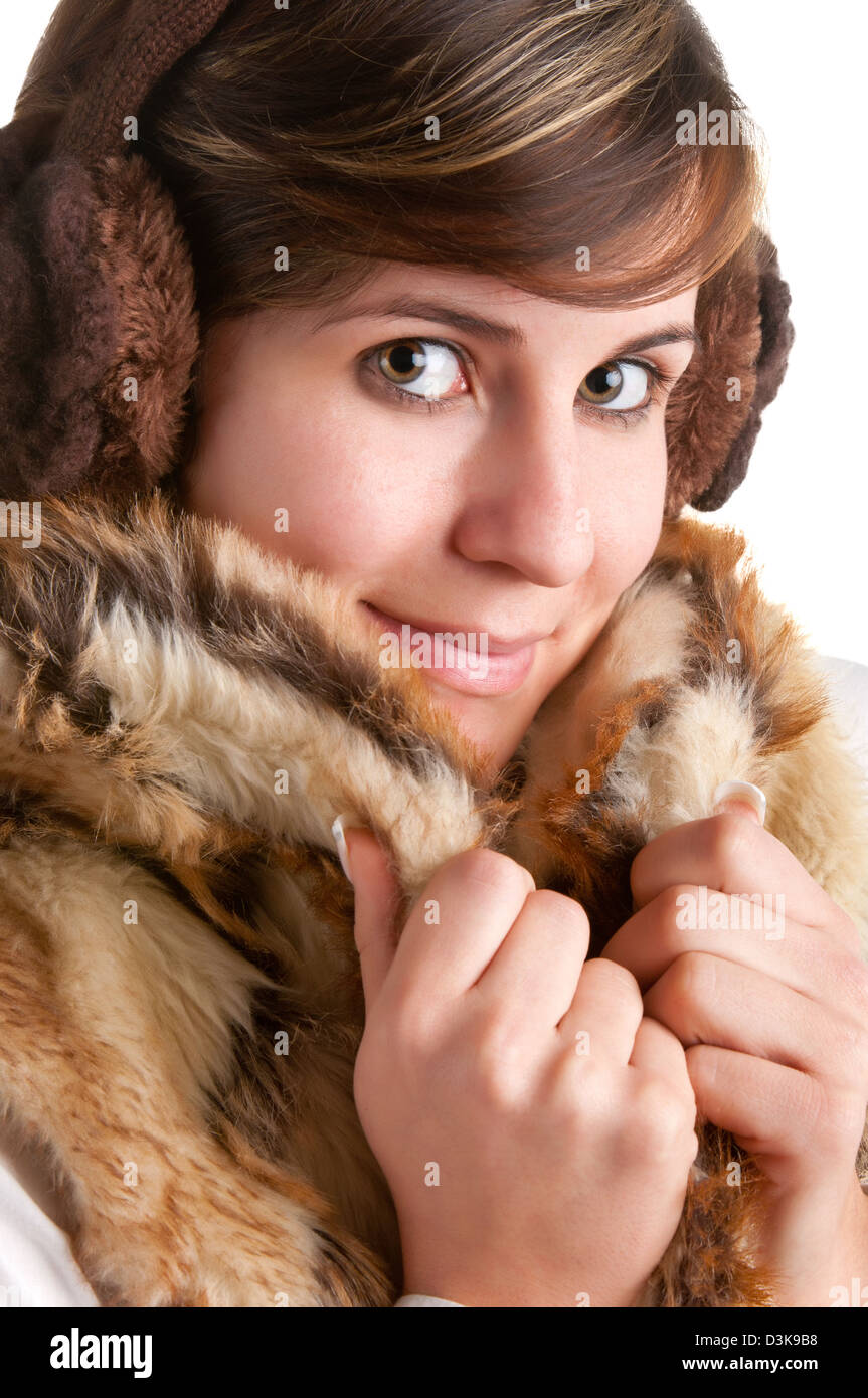 Cold Woman Snuggling in Warm Coat isolated in a white background - Stock Image