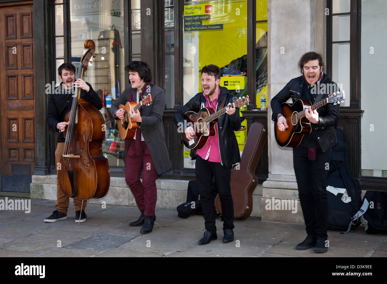 Licensed Buskers, teenagers in a Musical Group, a boy band quartet singing for donations.  A Group of four musicians - Stock Image