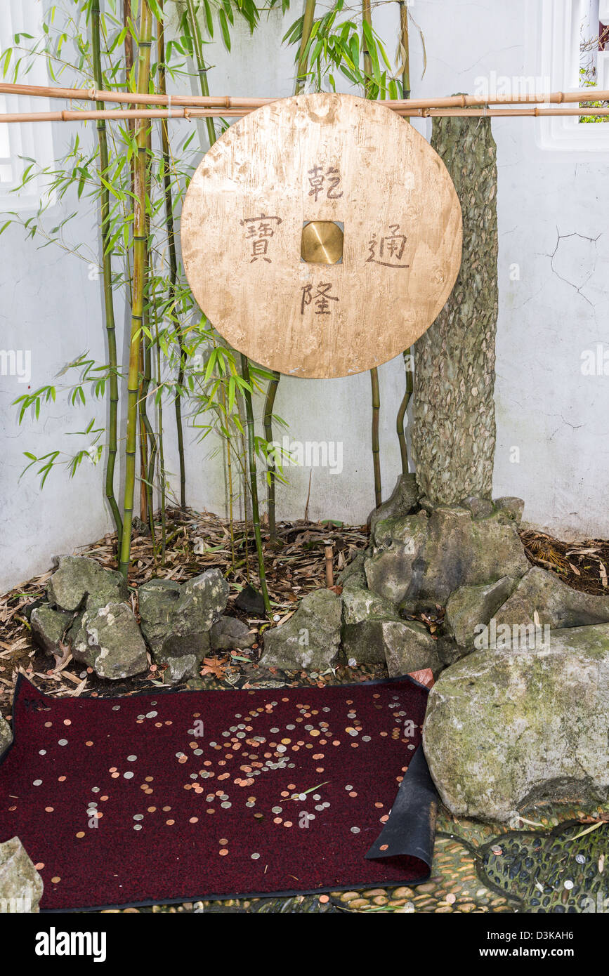 New Years coin toss for wishes, Dr Sun Yat Sen Garden, - Stock Image