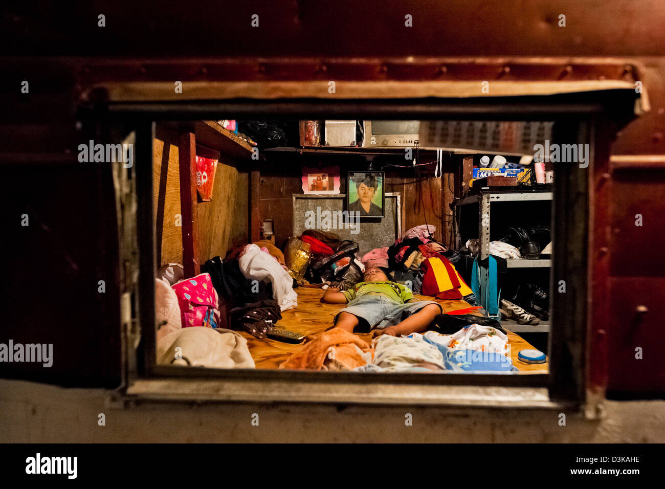 A Salvadorean boy sleeps in the trailer belonged to the Circo Brasilia, a family run circus travelling in Central - Stock Image