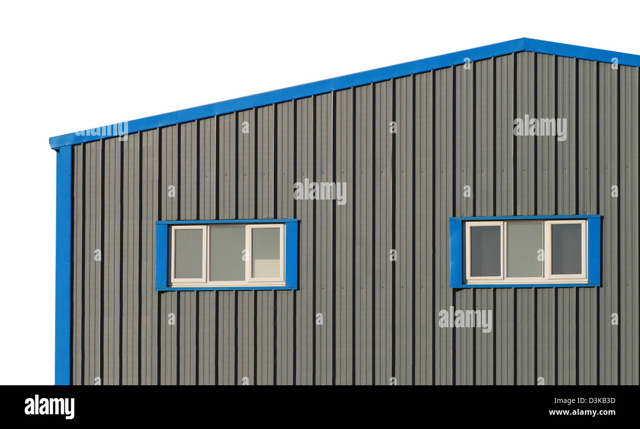 Exterior of commercial warehouse building isolated on white background. - Stock Image