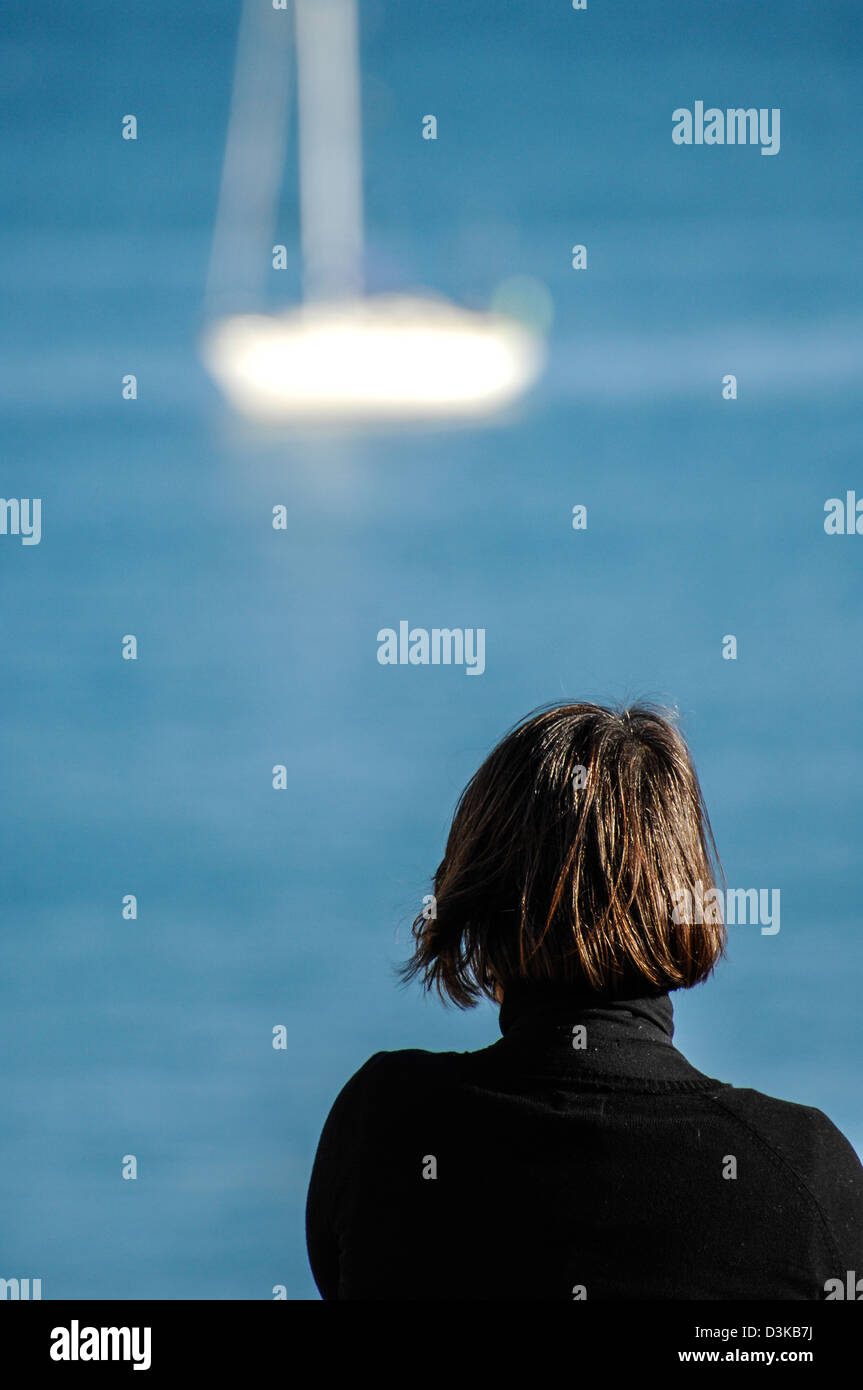 A lady alone with her thoughts - Stock Image