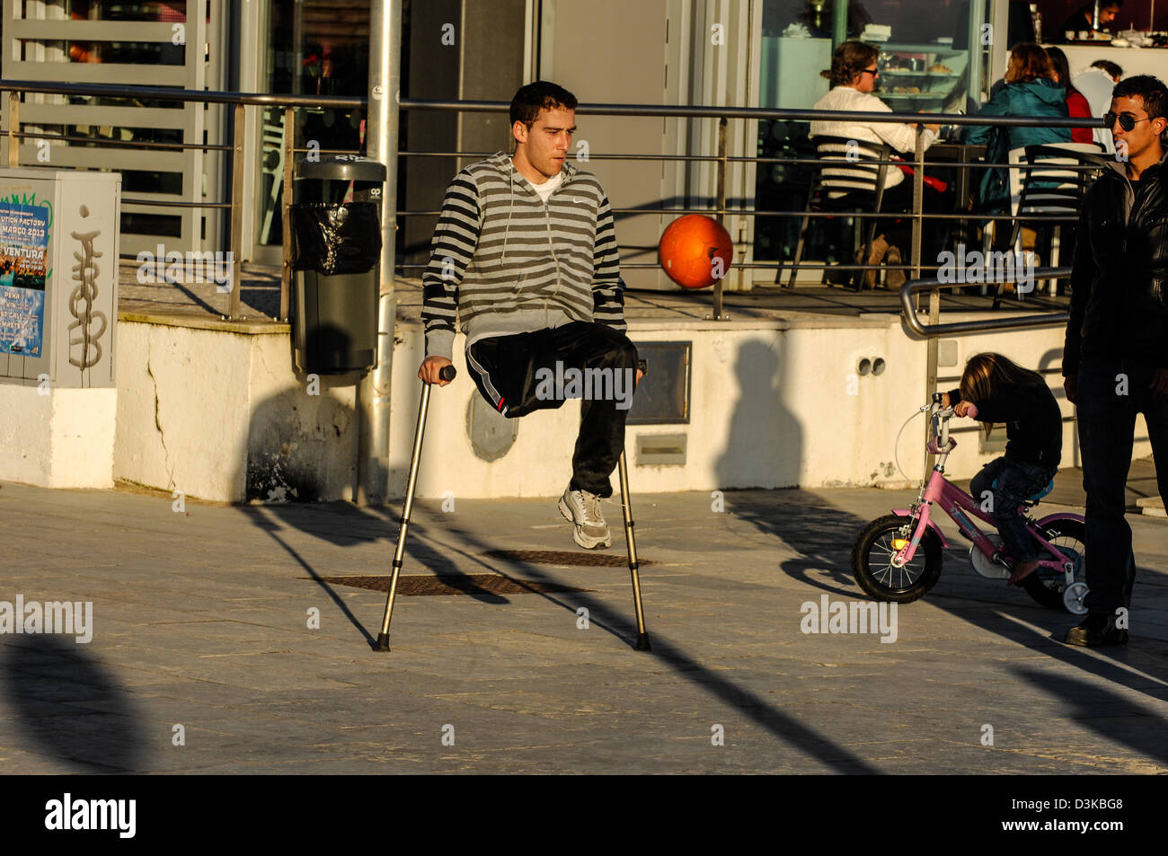 one legged footballer - Stock Image