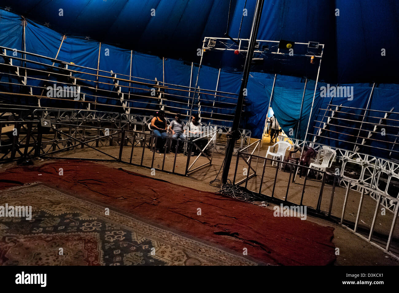 Circus visitors sit in front of the empty bleachers at the Circo Brasilia, a family run circus travelling in Central - Stock Image