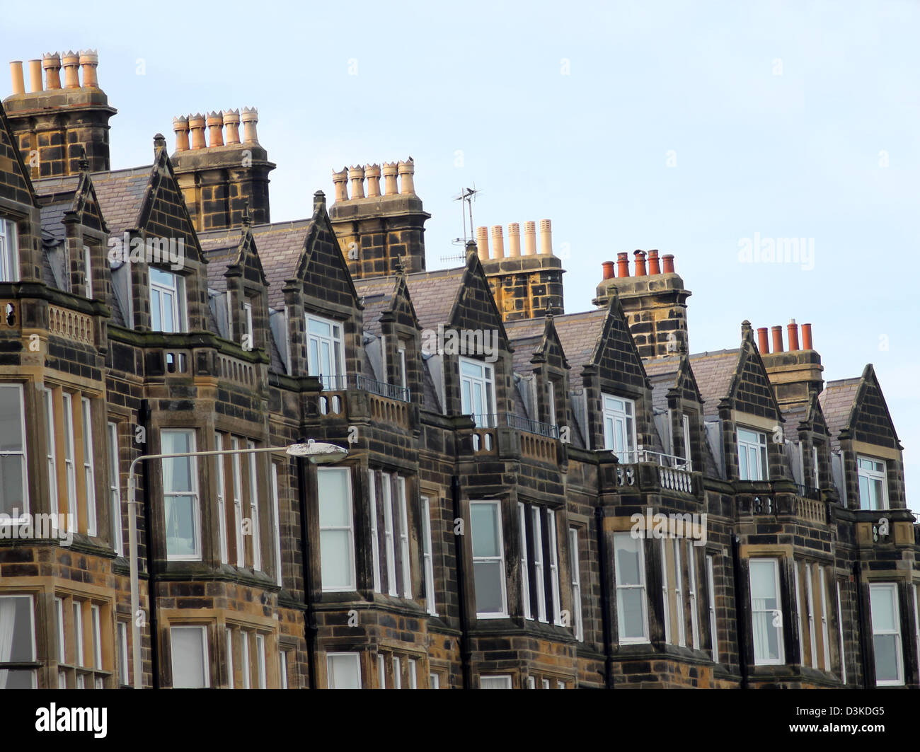 Row of old Victorian town houses on street in Scarborough, England. - Stock Image