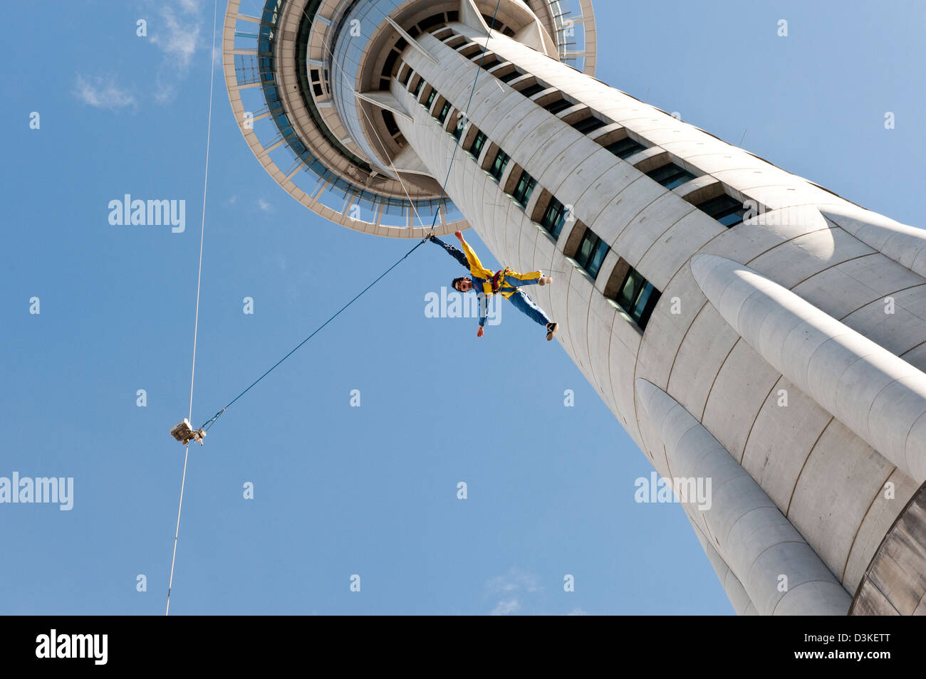Female base jumping off tower in New Zealand adventure sports sky jump bungy style New Zealand jumper jumping off - Stock Image