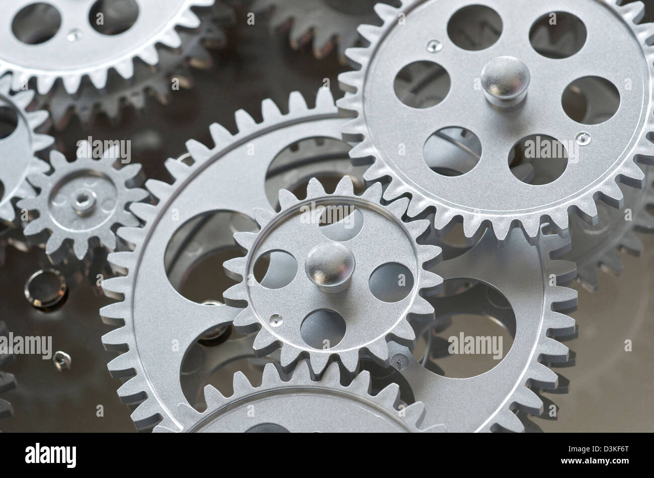 Gray gearing and gears interlocked. - Stock Image