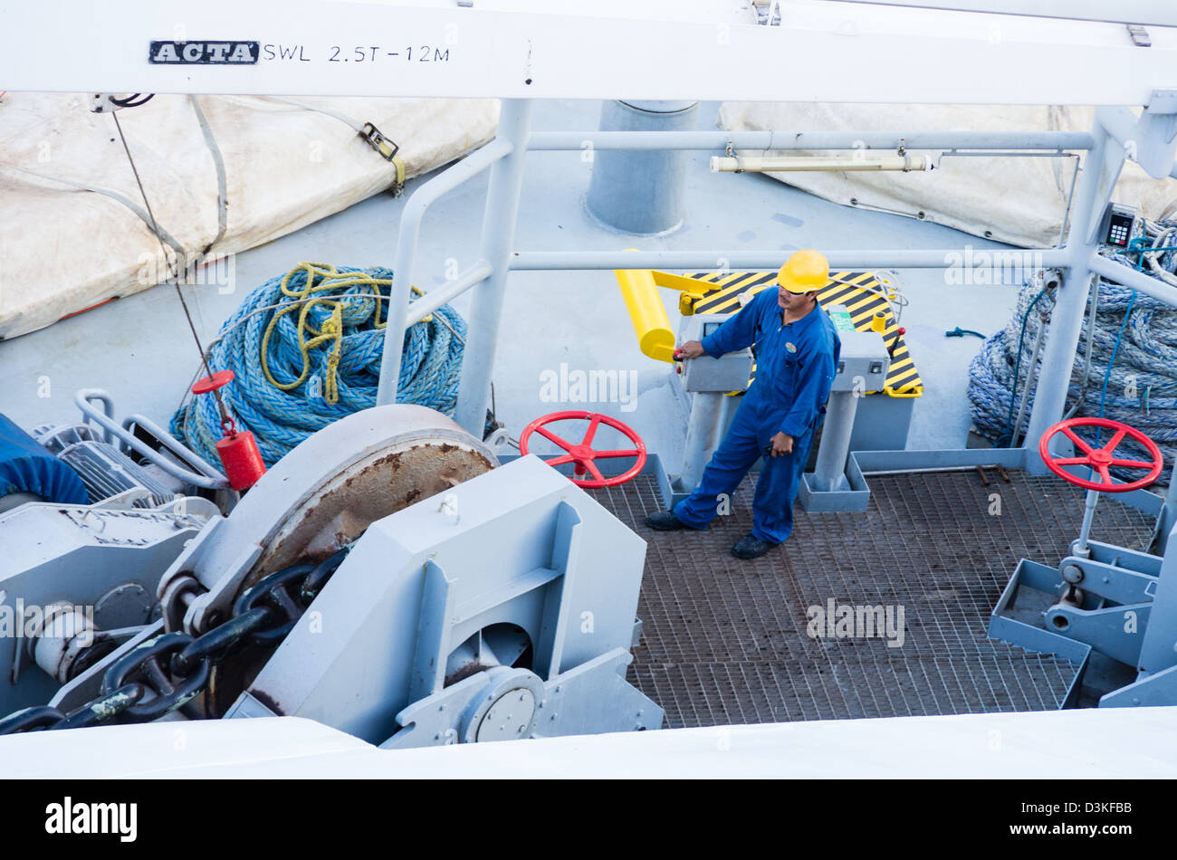 Samana, Dominican Republic, Crew members prepare to drop the anchor of a large cruise ship - Stock Image