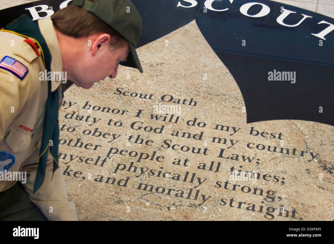 Scoutmaster of a Boy Scout troop for Boy Scouts of America,looking over the scout oath which includes,'Morally - Stock Image