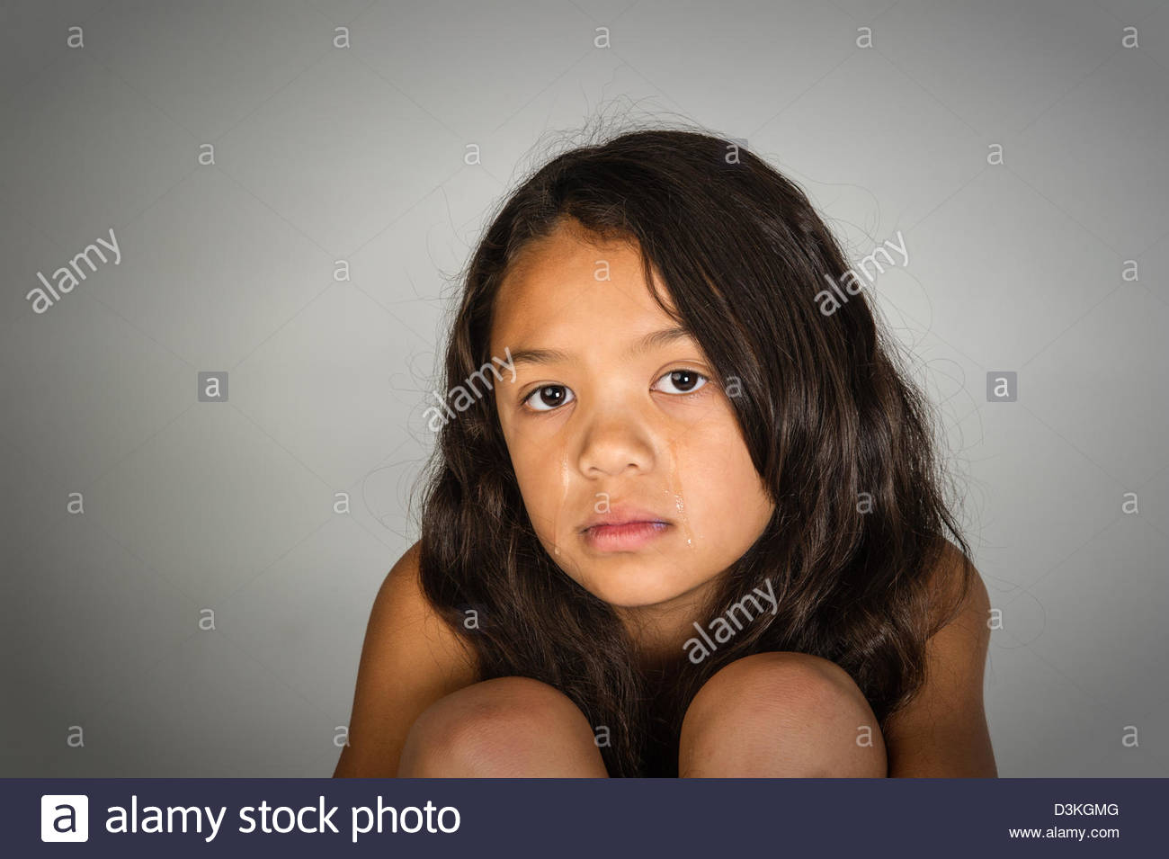 young girl with tears running down her face. - Stock Image