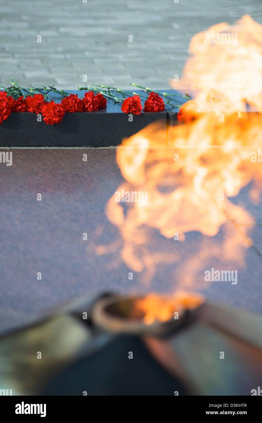 Floral tributes at the Aloysha war memorial in Murmansk Russia - Stock Image