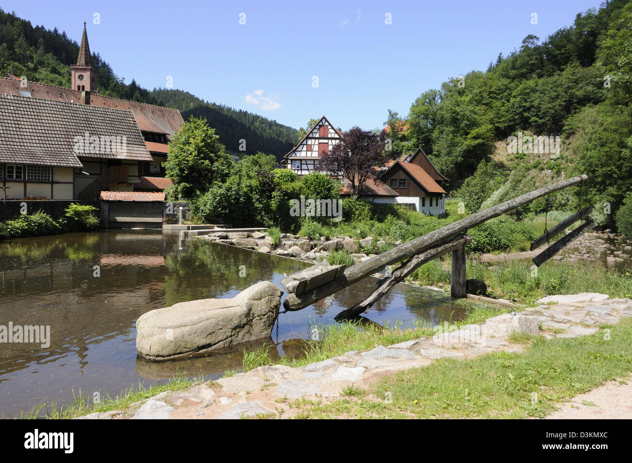 The weir on the river Kinzig, Schiltach, Black Forest, Germany. - Stock Image