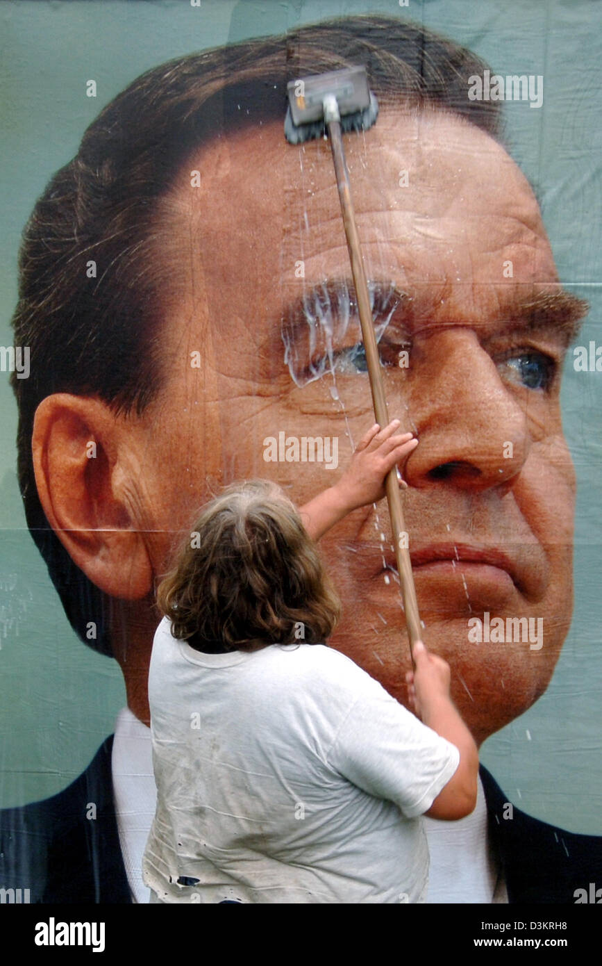 (dpa) - Billsticker Volker Przywara glues an election banner with the picture of German Chancellor Gerhard Schroeder Stock Photo