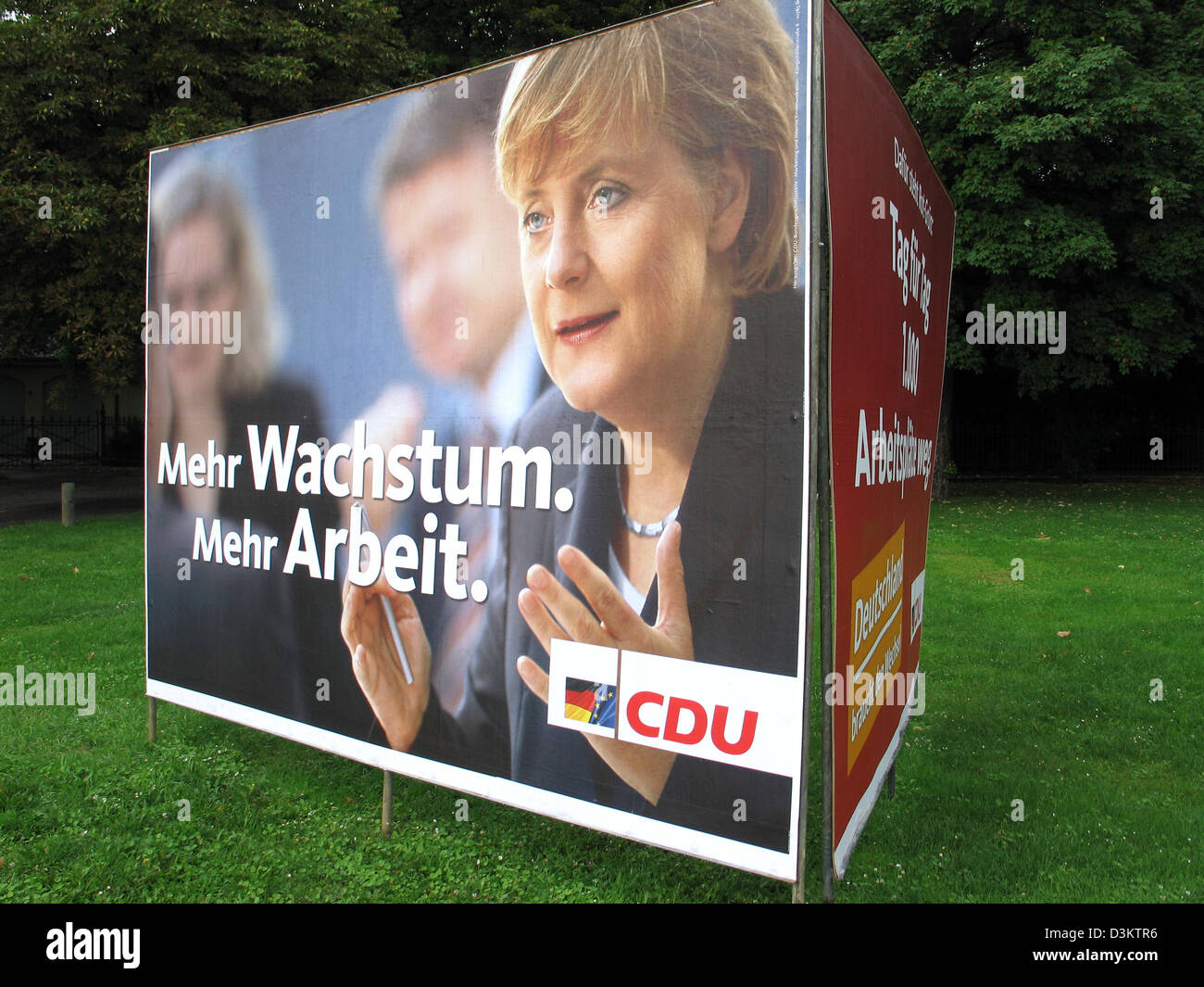 (dpa) - Angela Merkel, chairwoman of the Christian Democratic Party (CDU) and her party's top candidate for the chancellorship in Germany, is featured on an election poster of the CDU, which reads 'More growth, more jobs',  ahead of the general elections for the German Bundestag parliament on 18 September 2005, pictured in the state of North Rhine Westphalia, Germany on 23 August 2 Stock Photo