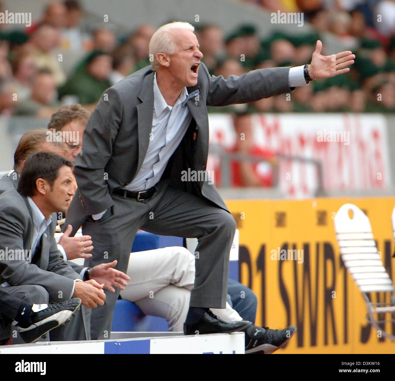(dpa) - Stuttgart's soccer coach Giovanni Trapattoni shouts instructions to his players on the pitch during the Stock Photo