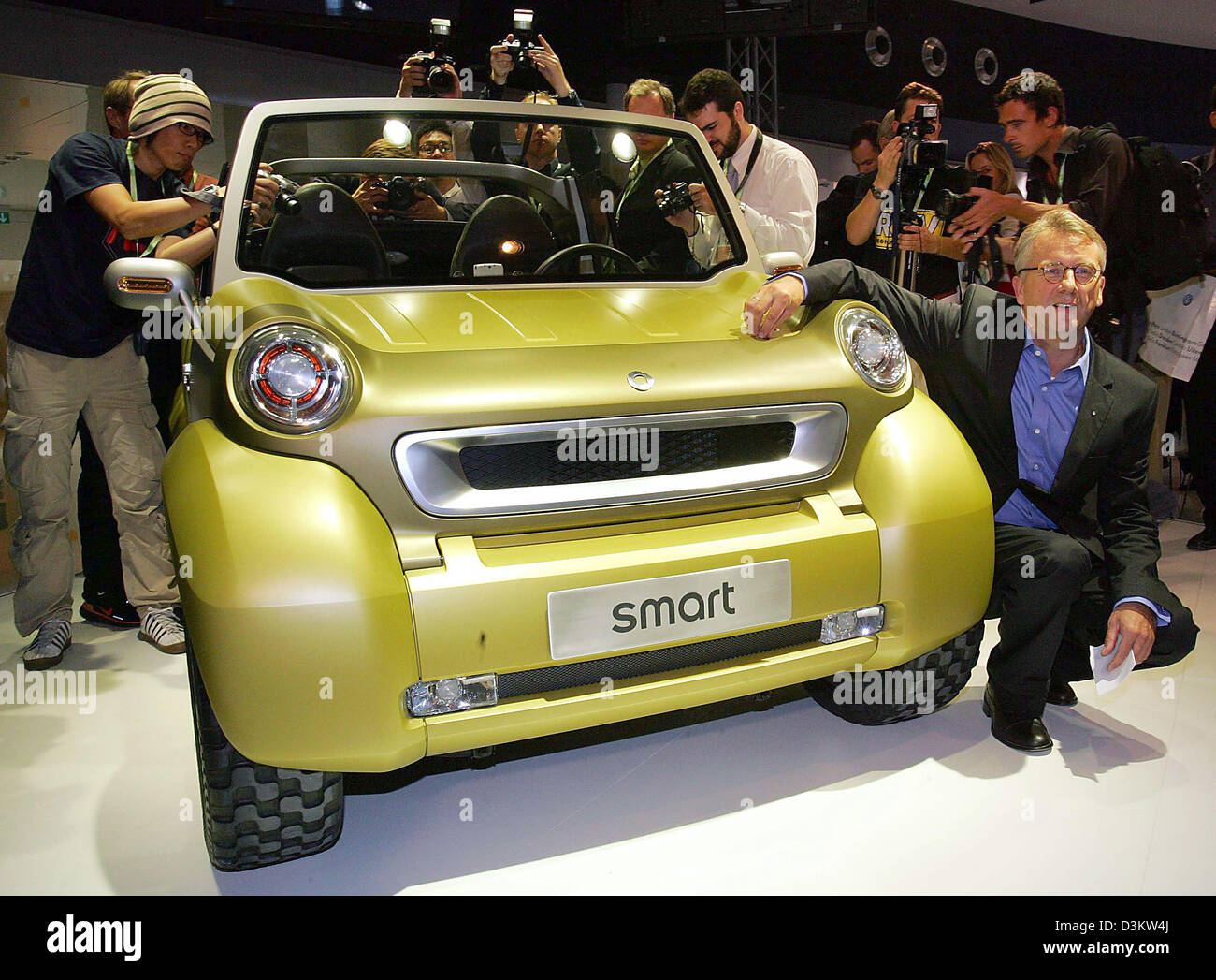 (dpa) - The picture shows President of Smart Ulrich Walker on his knees during the presentation of the new show - Stock Image