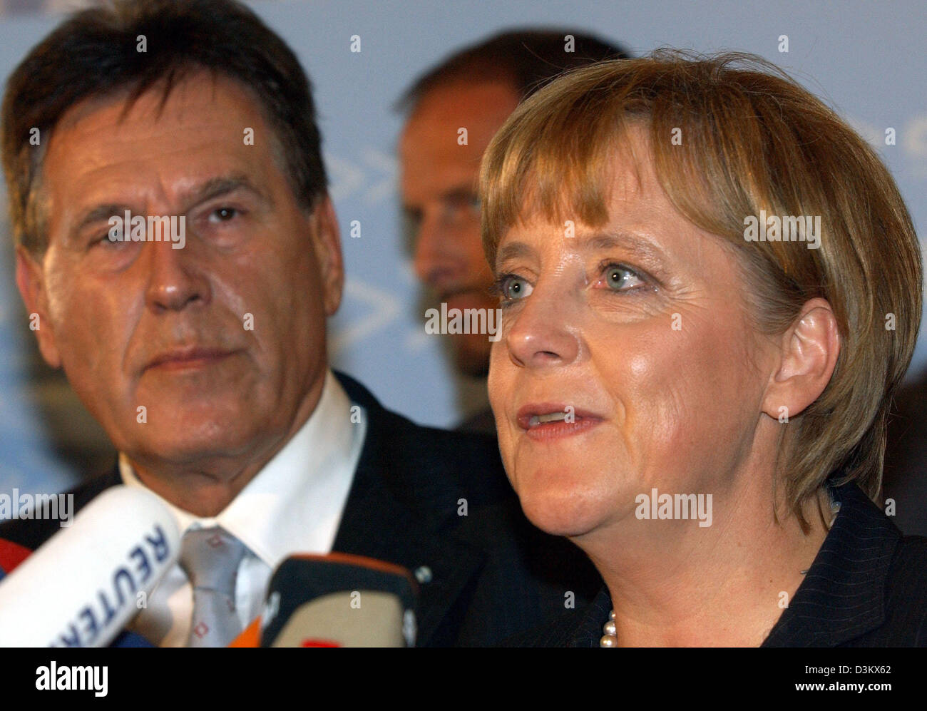(dpa) - Angela Merkel (R), Chairwoman of the CDU and chancellor candidate, stands next to Michael Glos, Head of the Bavarian CSU, during a short press conference after the session of the new elected parliamentary faction of the CDU/CSU in Berlin, Tuesday, 20 September 2005. Despite the week results in the general election for the German Bundestag, Merkel was re-elected by her party Stock Photo