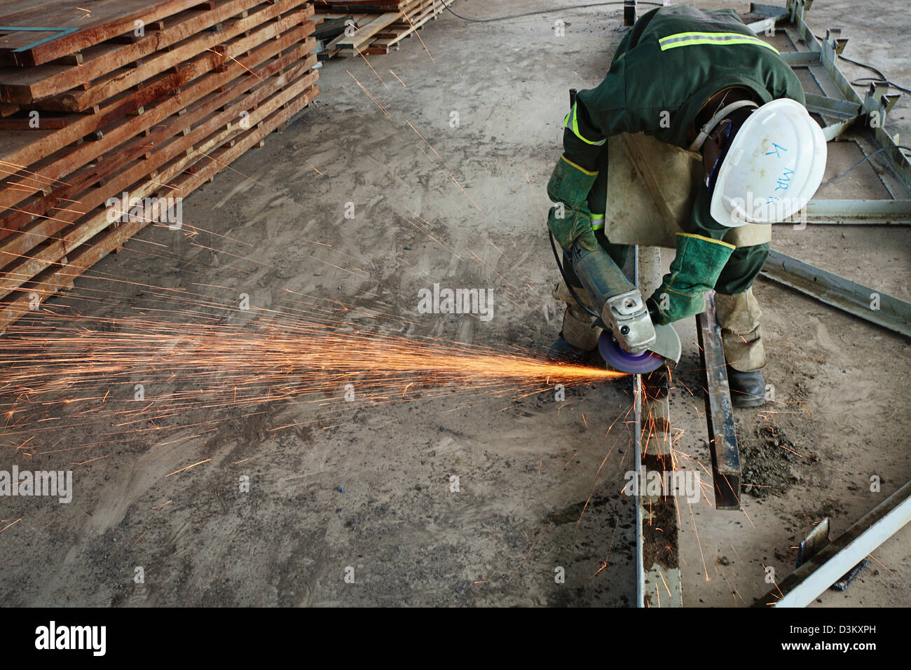 First Quantum employee grinding a metal structure - Stock Image