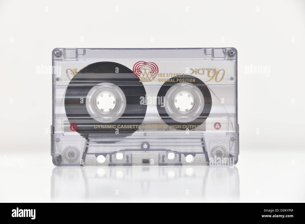 Old audio tape isolated on white background - Stock Image