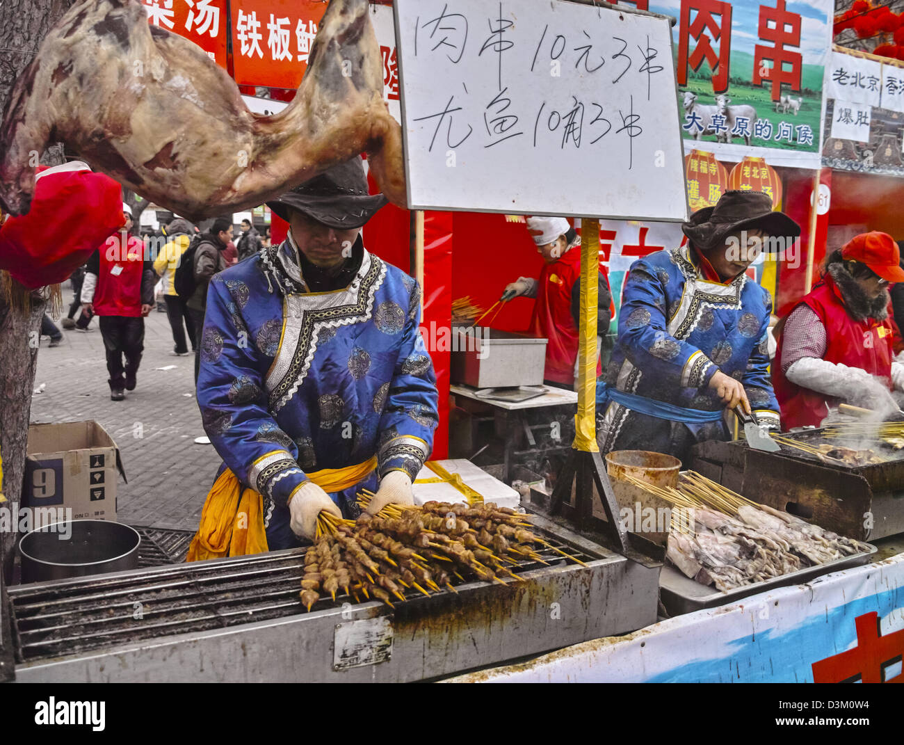 The stallkeepers in Chinese New Year Temple Fair - Stock Image
