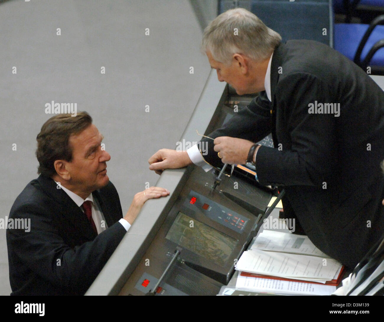 (dpa) - German Chancellor Gerhard Schroeder (L) talks to German Minister of the Interior Otto Schily ahead of the first session of the new Bundestag parliament at the Reichstag  in Berlin, Germany, Tuesday, 18 October 2005. The parliament has come together for the first time since the general election for the German Bundestag in September, in order to elect the new President of the Stock Photo
