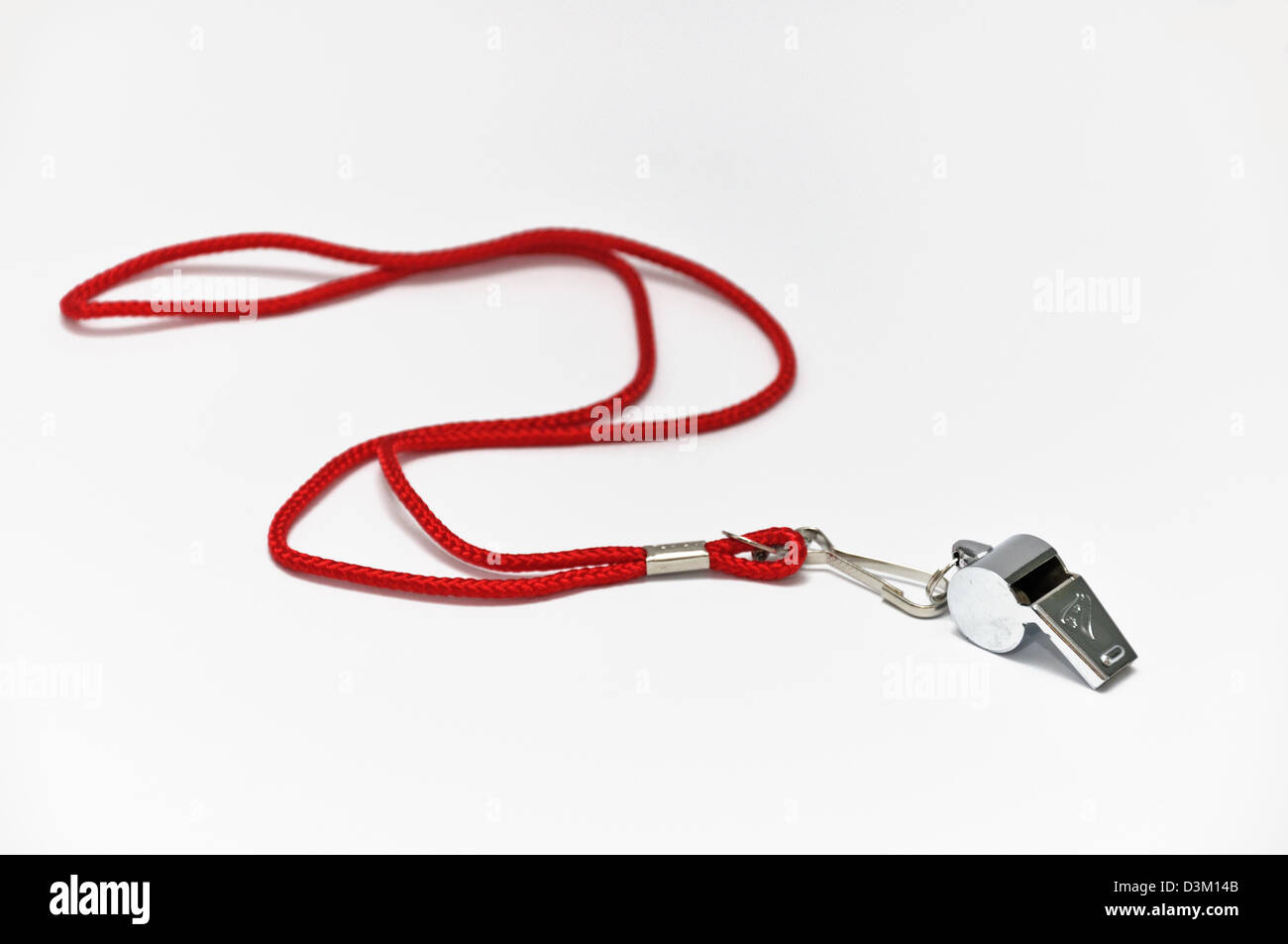 Silver whistle with red cord isolated on white - Stock Image