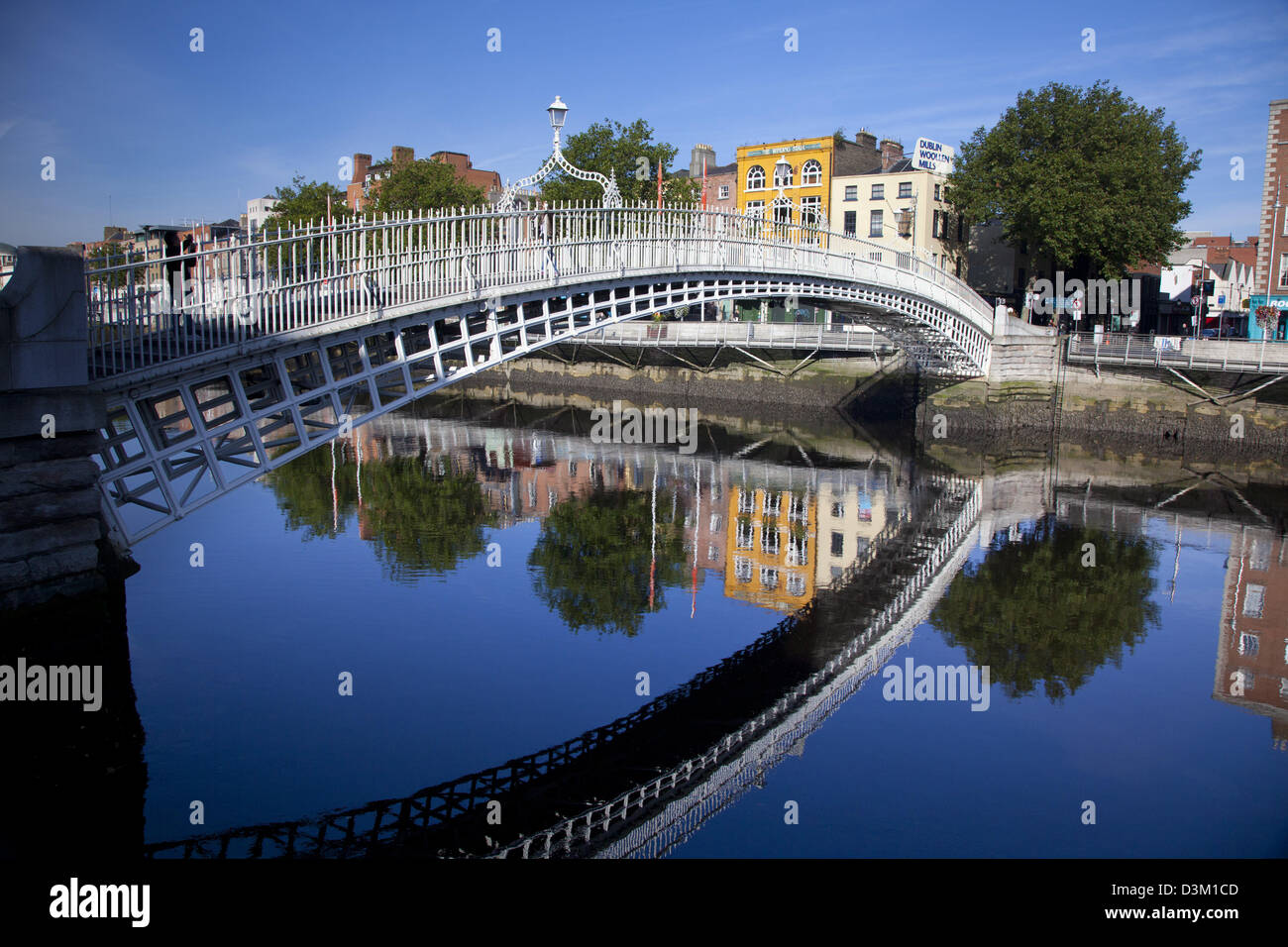 Reflection of Ha'penny Bridge in the River Liffey, Dublin city, County Dublin, Ireland. - Stock Image