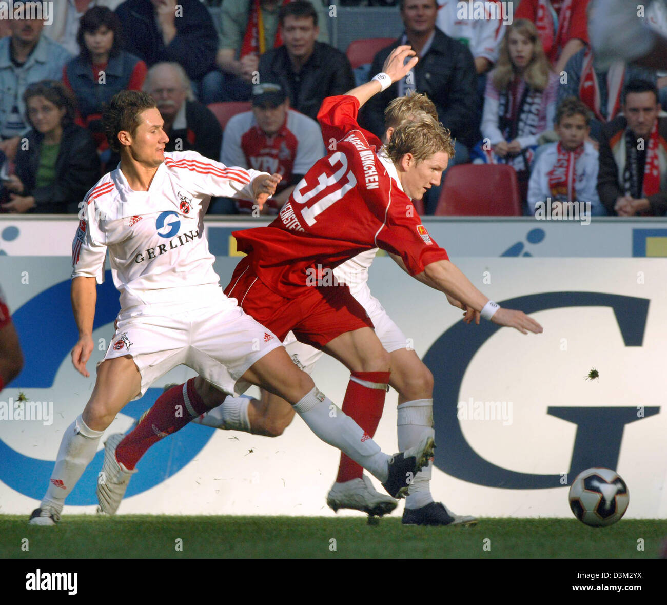 Player of German soccer club Bayern Munich Bastian Schweinsteiger (r) vies for the ball with Cologne player Albert - Stock Image