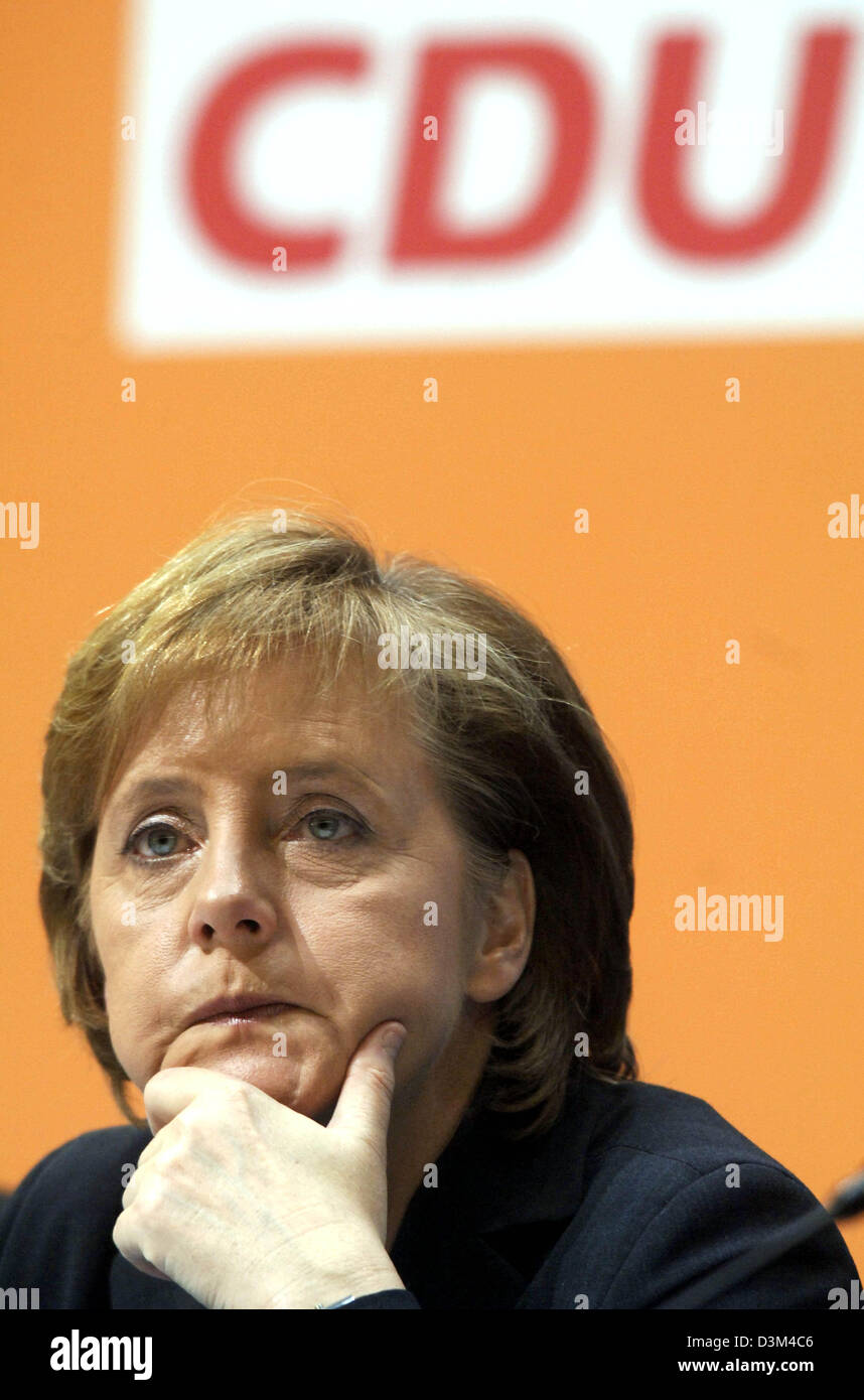 (dpa) - CDU Chairwoman and designated German Chancellor Angela Merkel sits at the podium during the CDU's small party convention in Berlin, Germany, 14 November 2005. Merkel defended the formation of a grand coalition. Photo: Tim Brakemeier Stock Photo