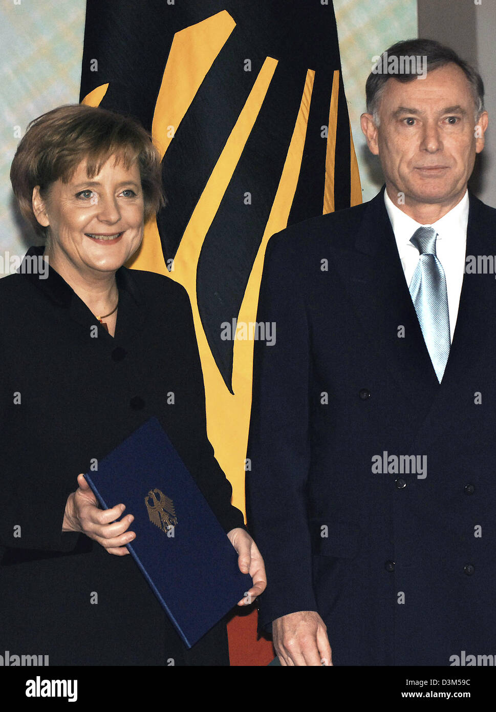 (dpa) - New elect German Chancellor Angela Merkel (CDU) is presented her certificate of appointment as German Chancellor Stock Photo
