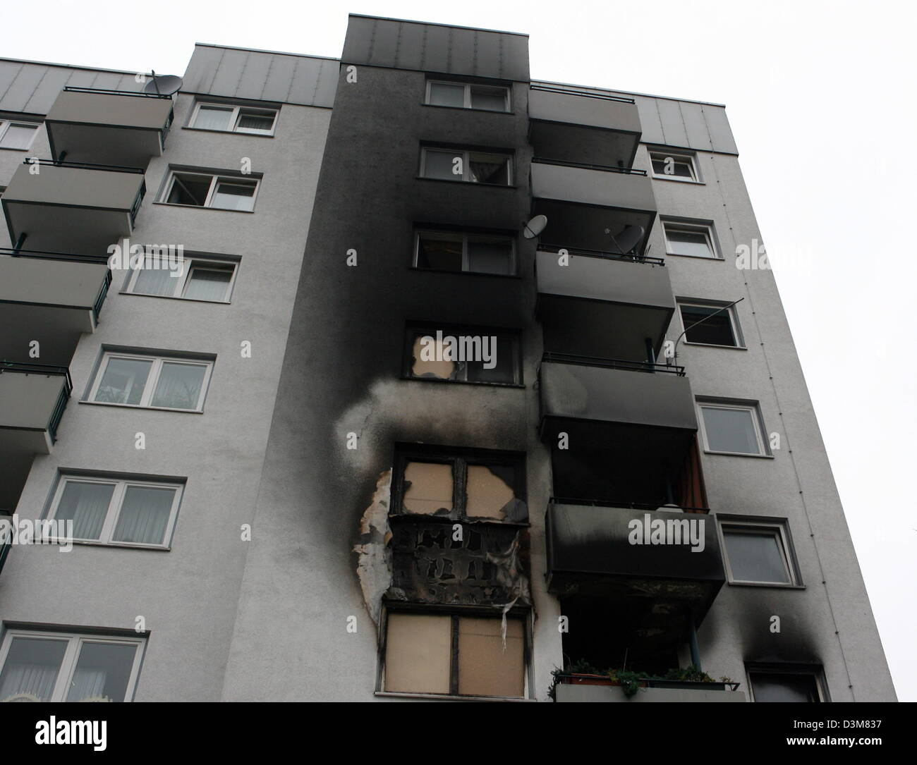 (dpa) - The photo shows the soot-stained facade of a seven-storey dwelling house in Cologne-Muelheim, Germany, 24 Stock Photo