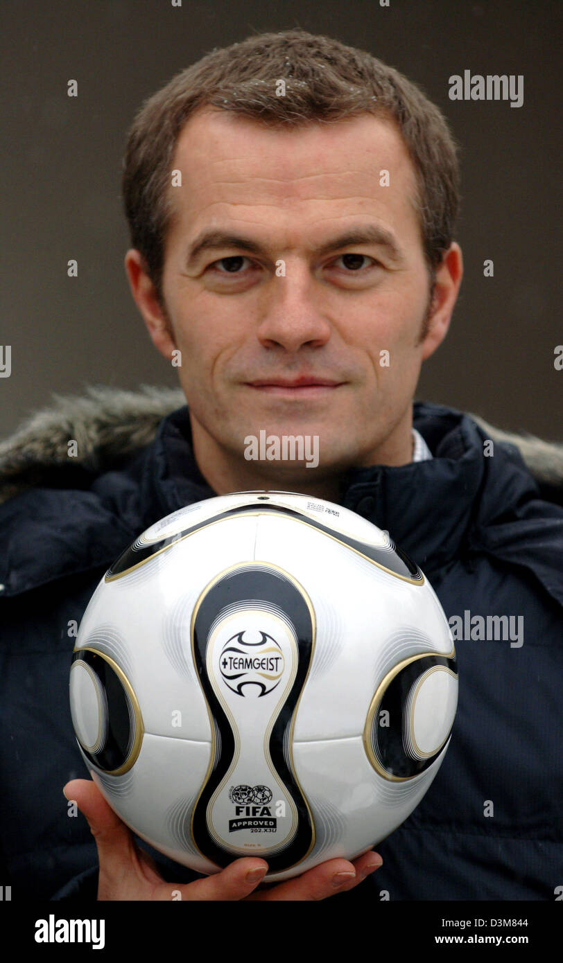 dpa) - Hans-Peter-Nuernberg presents Adidas latest soccer