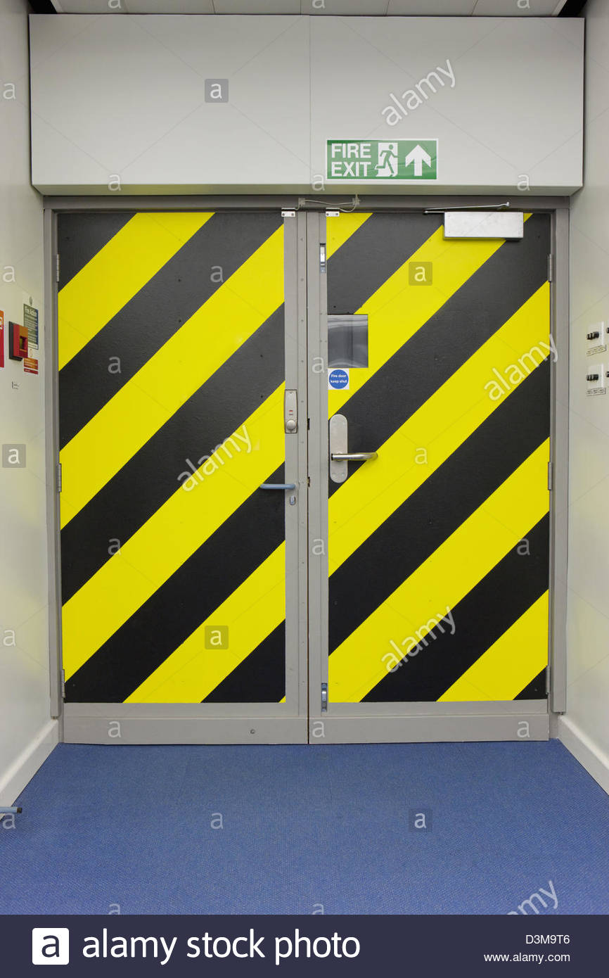Hazard stripes on exit doors - Stock Image