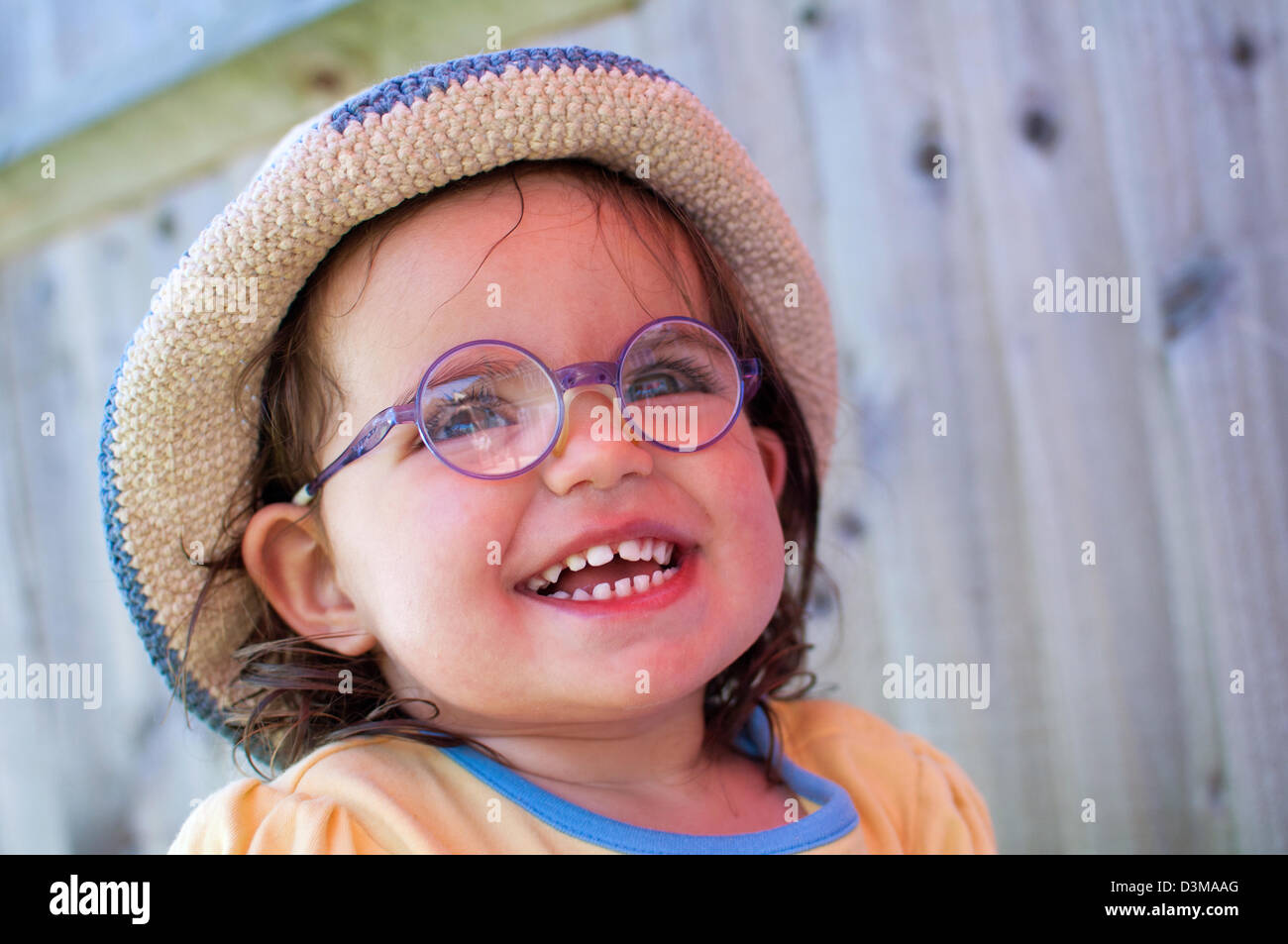 Girl, toddler in glasses - Stock Image