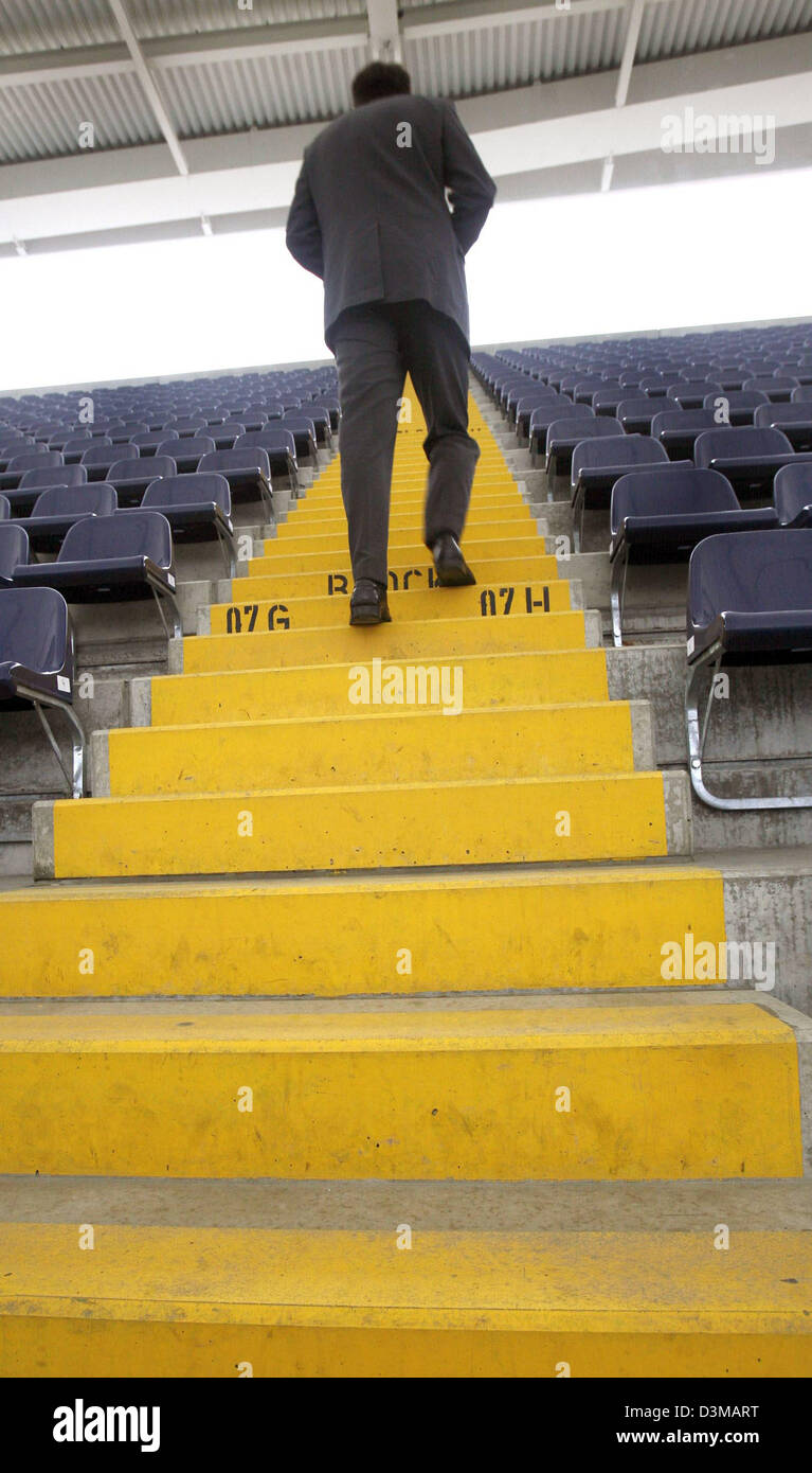 (dpa) - An employee of the stadium operator climbs the steps to the upper seats in the Commerzbank Arena stadium Stock Photo