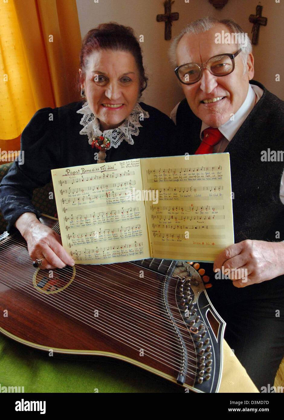 Annemarie and Hans Ramsauer, musicians, show the lyrics of