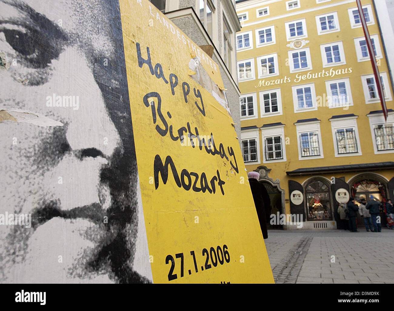 A poster with the writing 'Happy Birthday Mozart' stands near the entrance to the birthplace of the famous - Stock Image