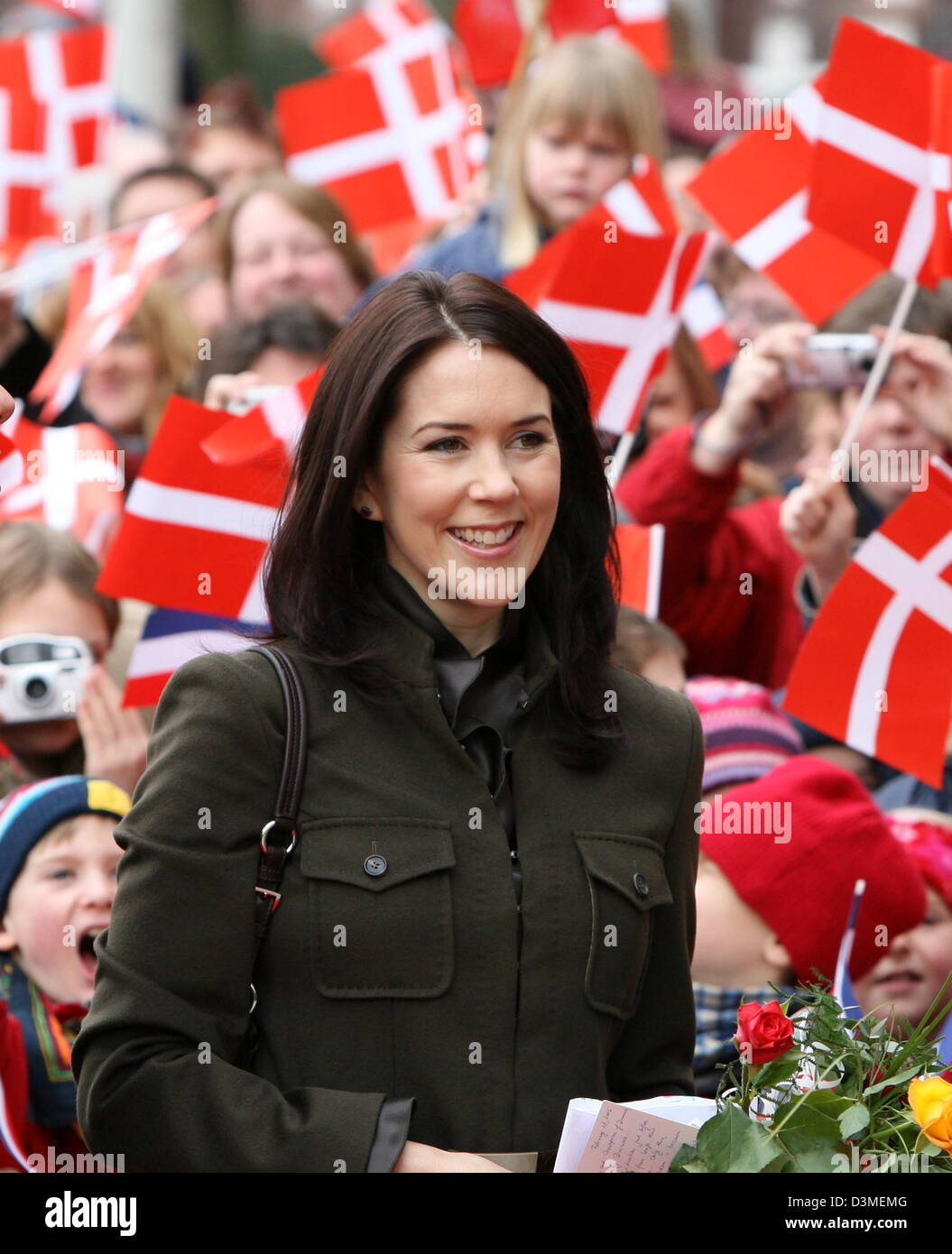 Danish Crown Princes Mary of Denmark smiles as she walks pass children swaying the Danish national flag as she arrives - Stock Image
