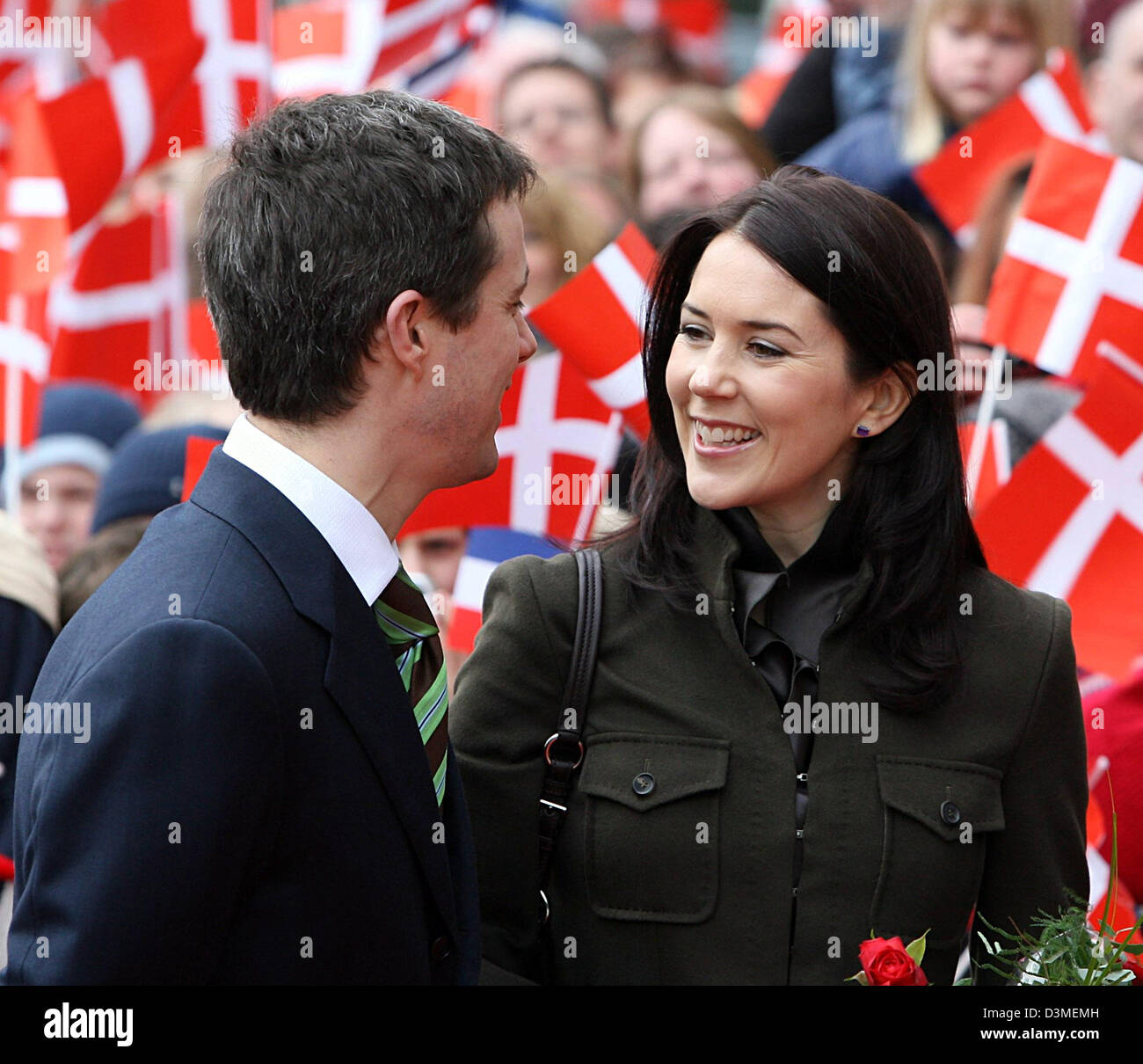 Danish Crown Prince Frederik and and his wife Princess Mary of Denmark smile as they look at each other on arrival - Stock Image