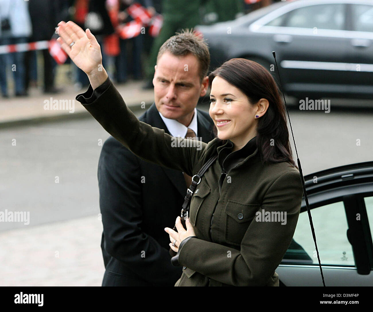 Crown Princess Mary of Denmark greets some spectators prior to lunch in a historic penny bank in Kiel, Germany, - Stock Image