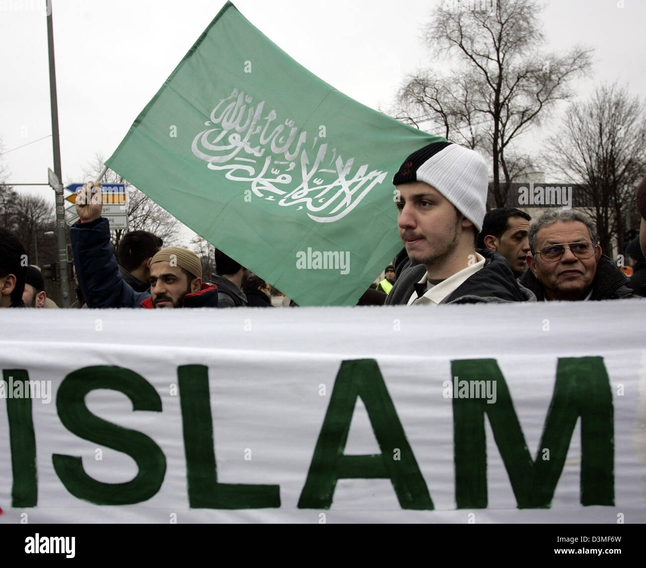 Holding banners and flags muslims protest in front of the Danish Embassy in Berlin, Saturday 25 February 2006. Around Stock Photo