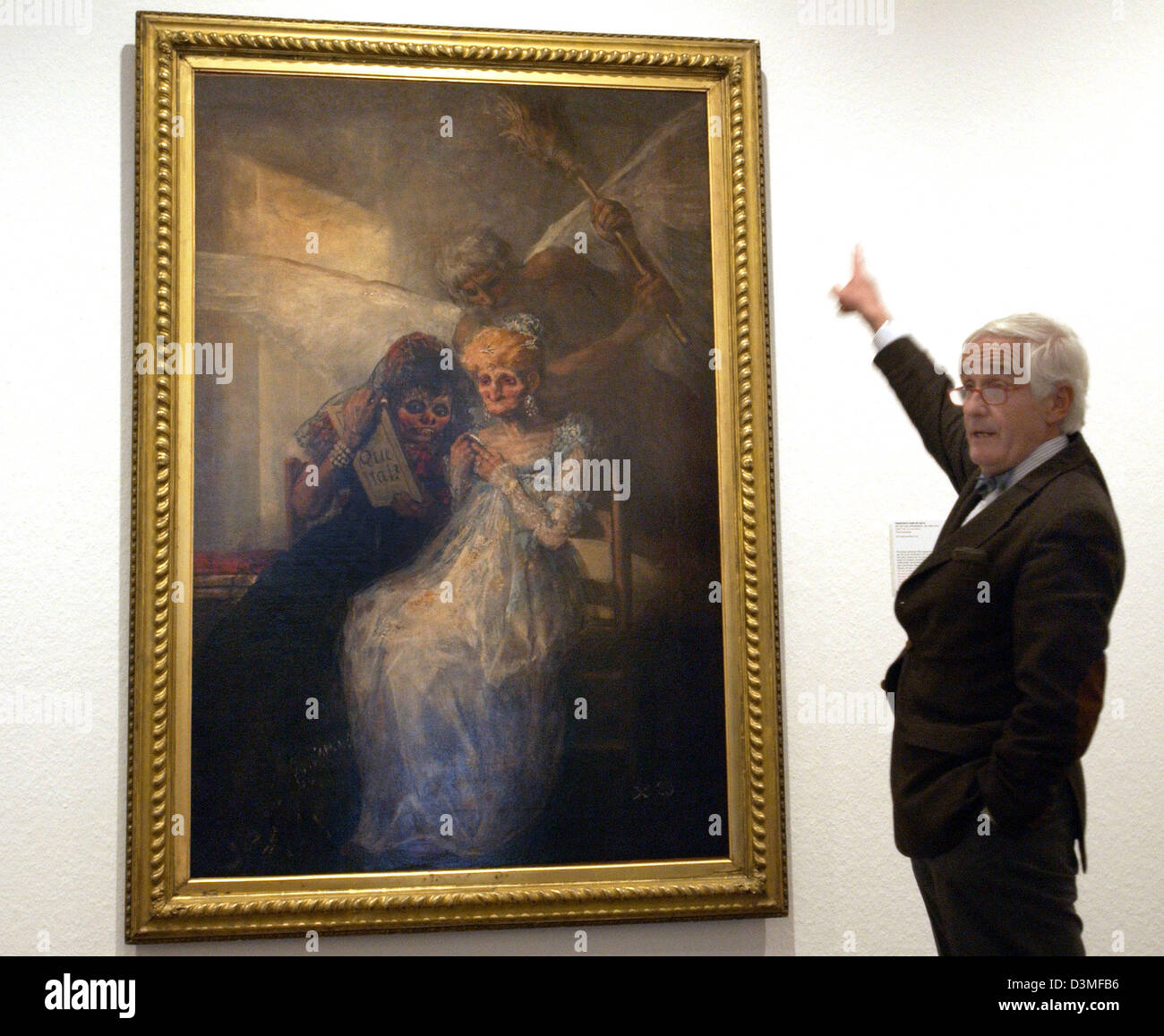Peter Raue, chairman of the friends of the National Gallery association, points at the painting 'The hours (aged Stock Photo