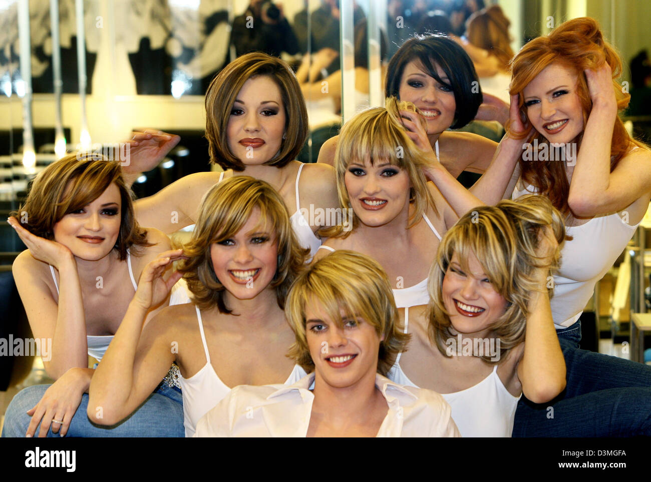 Models present the newest hairstyles at a photocall for the trade fair 'Top Hair International' in Duesseldorf, Stock Photo