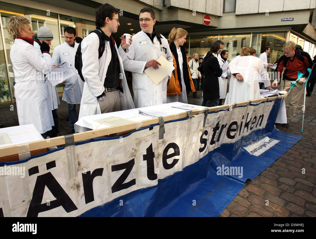 Striking physicians inform the public about their strike with a stall in the city centre of Freiburg, Germany, Monday - Stock Image