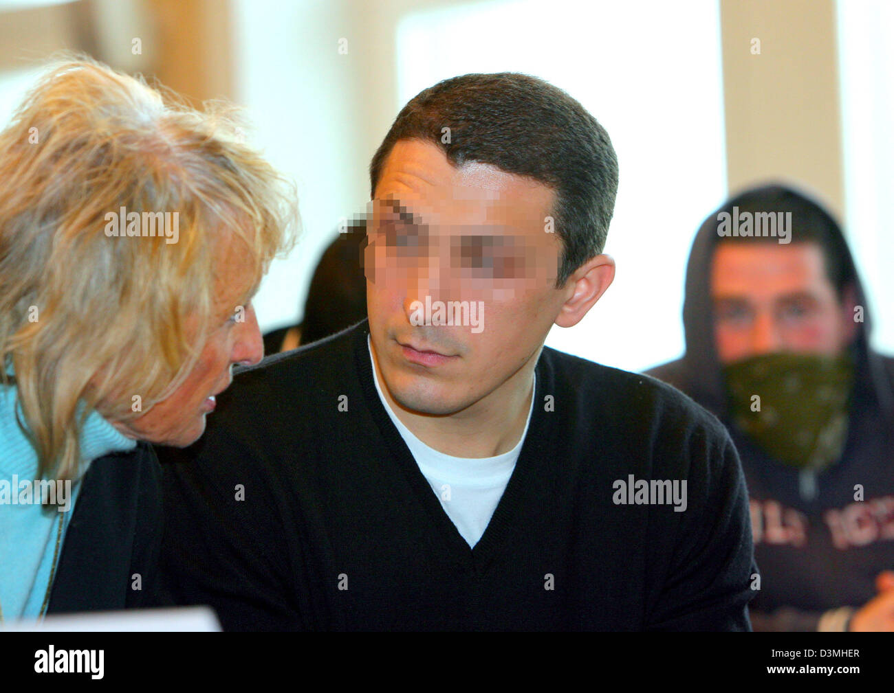The alleged head of a criminal gang from the Rostock red-light district Lithuanian Artur B. (C) talks to his lawyer - Stock Image