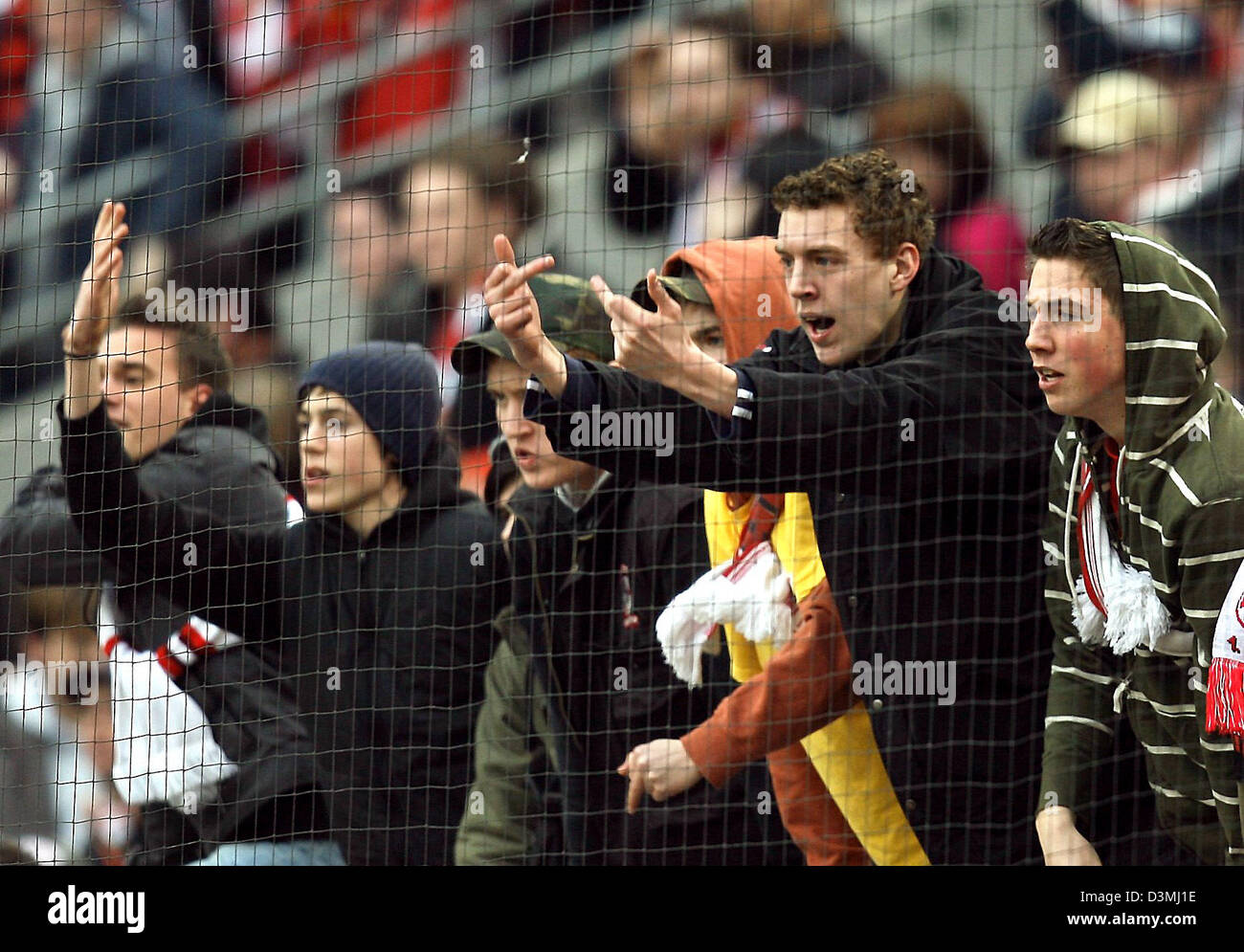 Cologne supporters gesture and voice their discontent to the players on the pitch after the  Bundesliga soccer match - Stock Image